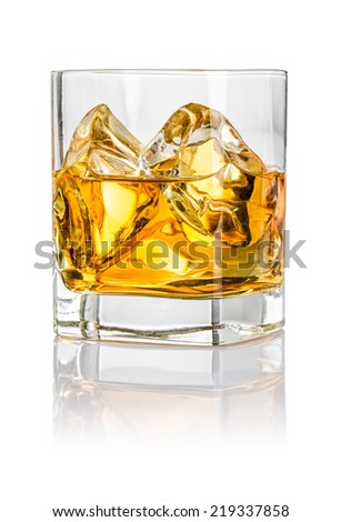 Tumbler with whiskey on the rocks - stock photo