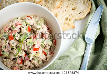 Tuna and avocado salad served in a bowl with ciabatta toasts - stock photo
