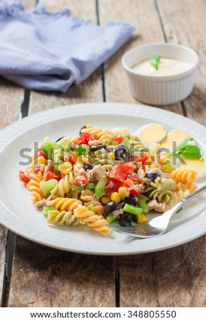 tuna and sauce pasta salad with fork - stock photo