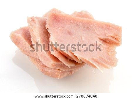 Tuna. Canned fish isolated on white. Macro.