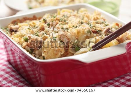 Tuna casserole with pasta and crumbs - stock photo