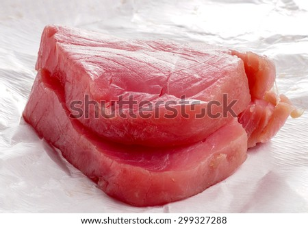 Tuna fish, fresh steaks ready for cooking an meal - stock photo