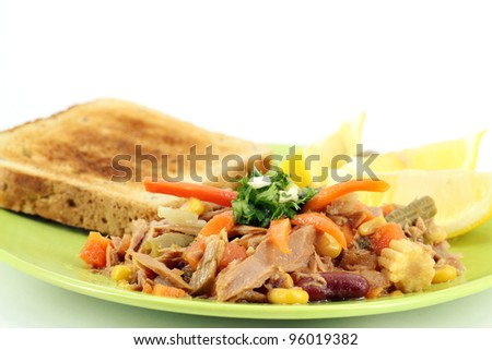 tuna fish with salad and bread