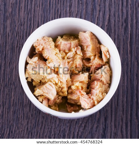 Tuna in a white cup, square image - stock photo