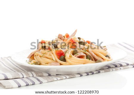 Tuna pasta with capers and fresh vegetable. Culinary seafood eating. - stock photo