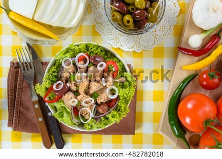 Tuna salad and tasty selection of vegetables.