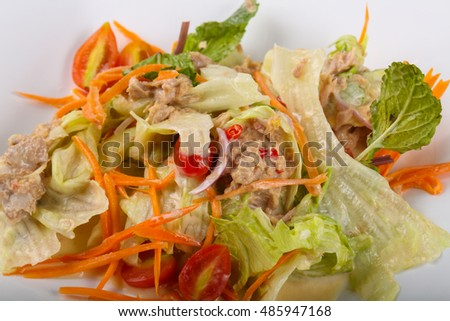 Tuna salad  with carrot and chili pepper