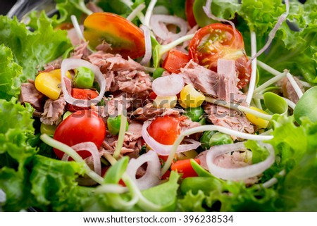 Tuna salad with lettuce and tomatoes.