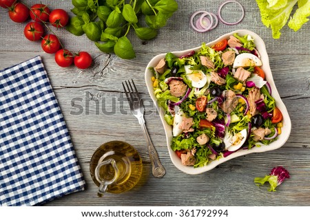 Tuna salad with lettuce, eggs and tomatoes. - stock photo