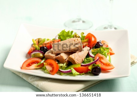 tuna salad with tomatoes green salad and olives - stock photo