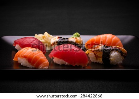 Tuna, salmon and eel sushi on dark background, close up - stock photo