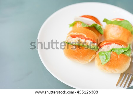 Tuna sandwich bread with tomato and lettuce with copyspace. food background concept - stock photo
