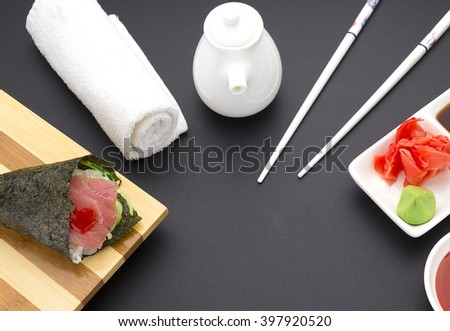 Tuna sashimi on a wooden plate with ginger wasabi sauces over black background - stock photo