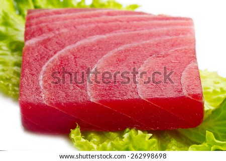 tuna sashimi with salad on white background - stock photo