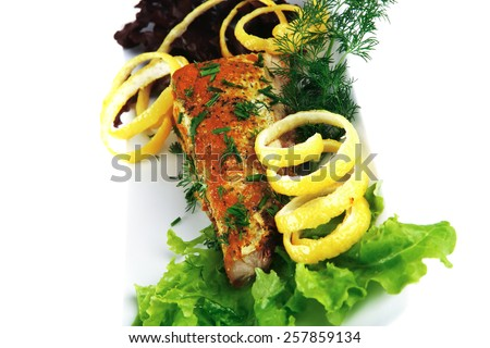 tuna steak on red porcelain dish with vegetables  - stock photo