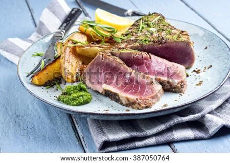 Tuna Steak with Home Fries - stock photo