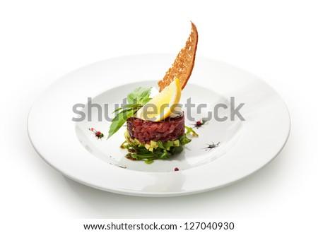 Tuna with Avocado Tartare with Lemon Slice - stock photo