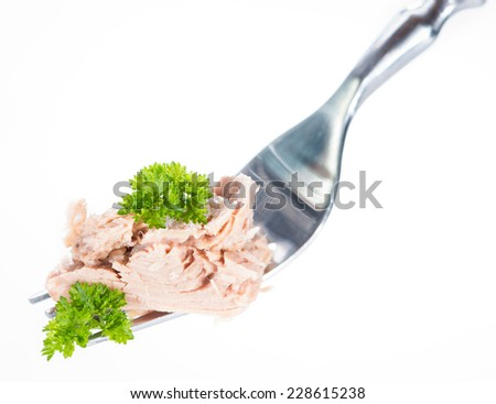 Tuna with parsley on a fork (isolated on pure white background) - stock photo
