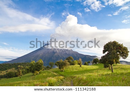 Tungurahua Volcano landscape, erupting at sunrise throwing smoke and ashes - stock photo