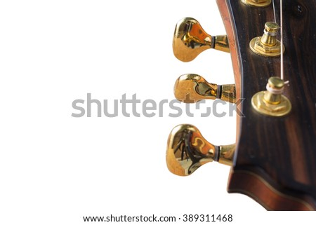 Tuning head for acoustic guitar/musical instrument /guitar headstock isolated on white - stock photo