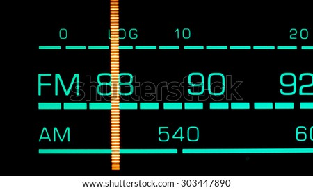 Tuning into 88 MHz FM on an old 70s radio receiver - stock photo