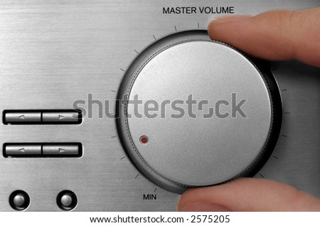 Tuning knob and fingers. Silver radio close-up. - stock photo