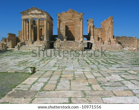 Tunisia. Ancient Sufetula (present day Sbeitla). Forum and three temples (dedicated to Minerva, Jupiter and Juno - in order from left to right) - stock photo