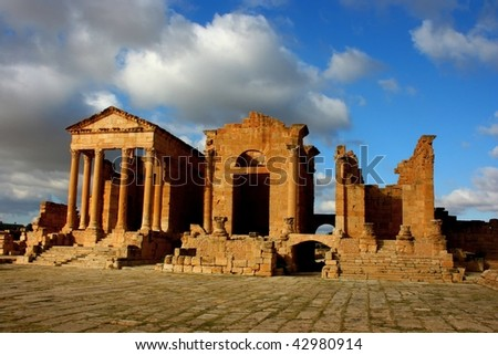 Tunisia. Ancient Sufetula (present day Sbeitla). The forum - view of the portico (fragment of colonnade) and three temples - stock photo