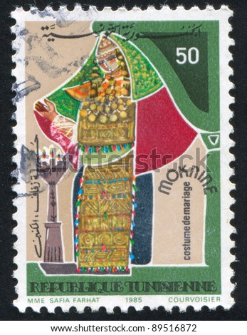 TUNISIA - CIRCA 1985: A stamp printed by Tunisia, shows Regional bridal costume, Moknine, circa 1985