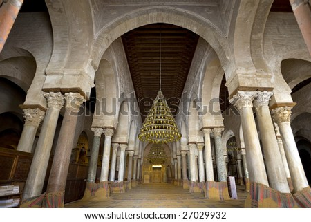 Tunisia. Kairouan - the Great Mosque. The prayer hall with imposing arches and Roman columns (taken from ruined sites) - stock photo
