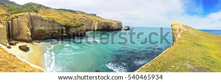 Tunnel Beach panorama - southwest of the city centre of Dunedin, New Zealand. Tunnel Beach has sea-carved sandstone cliffs, rock arches and caves.