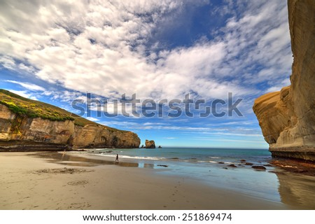Tunnel beach surrounded by rocks, Dunedin, South island of New Zealand - stock photo