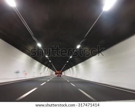 tunnel car motion blur night traffic fast - stock photo