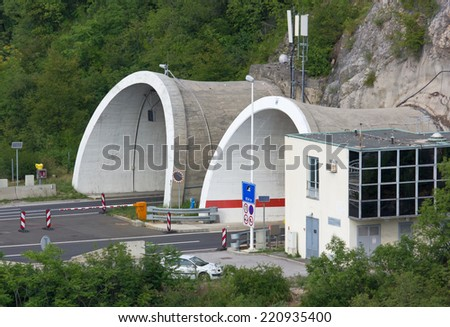 Tunnel Entrance and Exit on a Motorway - stock photo