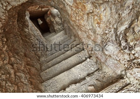 Tunnel in stone wall in the Dolomites - stock photo