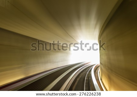 Tunnel of light. Subway tunnel with blurred light tracks - Concept of modern metro underground transport and connection speed. Motion blur effects due to long exposure shot - stock photo