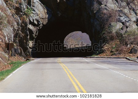 Tunnel on country highway - stock photo