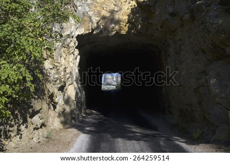 Tunnel on Iron Mountain Road in Black Hills framing view of Mount Rushmore National Memorial, South Dakota - stock photo