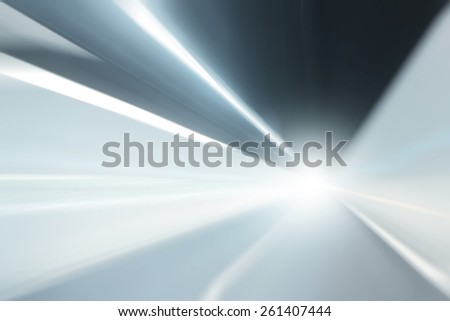 Tunnel silver blue color lights acceleration speed motion blur with light flare effect. Motion blur visualizies the speed and dynamics. - stock photo