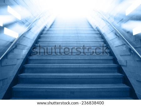 tunnel Staircase going up to the light,abstract cool blue monotone - stock photo