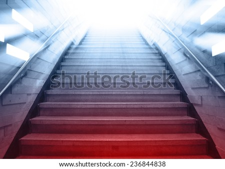 tunnel Staircase going up to the light,cool blue tone with red emergency light - stock photo