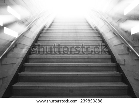 tunnel Staircase going up to the light,gray color monotone picture - stock photo