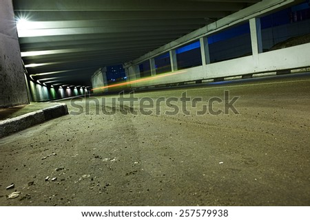 Tunnel with car's light traces - stock photo
