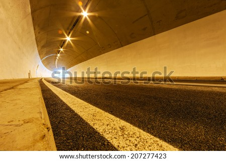 Tunnel with lights and moving cars