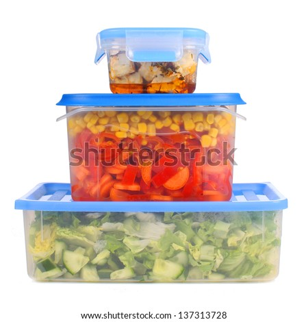 Tupperware storage with vegetables - stock photo