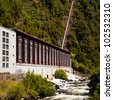 Turbine generator house of operating small scale hydro electric power plant - stock photo