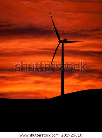 Turbines. Wind farm at sunset - clean energy, power generation etc. - stock photo