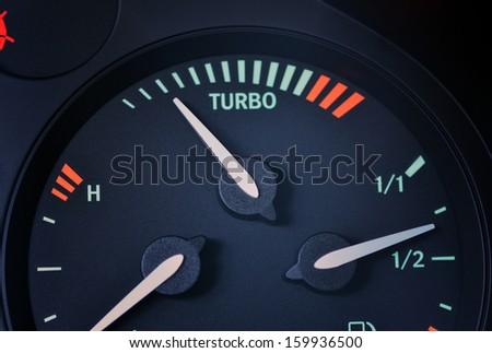 Turbo boost indicator, dashboard closeup - stock photo