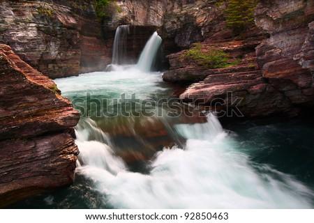 Turbulent waters of Saint Mary Falls at Glacier National Park - Montana - stock photo