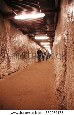TURDA, ROMANIA - MARCH 6: Tourists visiting the newly renovated Turda salt mine. In the underground salt mine, the salt was extracted from the Middle Ages. On March 6, 2010 in Turda, Romania - stock photo